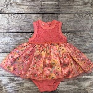 A55 -  Swiggles infant girls lace romper